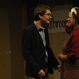"""Students Cashel O'Malley ('16) and Caragh Tiernan ('14) perform in """"Noises Off,"""" the show that several alumni attended."""