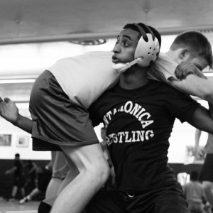 FIREMAN'S CARRY: A method of grounding an opponent is executing a fireman carry, named after the way firemen transport injured civilians. To perform a fireman carry, Lewy Negash ('15) reaches his arm between opponent Connor Stewart's ('16) legs, and uses his leverage to flip Stewart over his shoulders and place him on the mat.