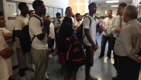 Samo football players dressed in white quietly protest outside the M-House office on Thurs. Sept. 11. Varsity wide receiver Dymund Richardson ('15) speaks with O-House Interim Principal Greg Runyon, M-House Principal and Athletics Administrator Elias Miles, football coach and math teacher Pat Dunn.