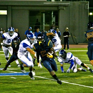 Running back Zach Cooper ('16) runs upfield towards the end zone during Samo's first home game. Samo proceeded to defeat Palisades High School 15-7 on Sept. 12.