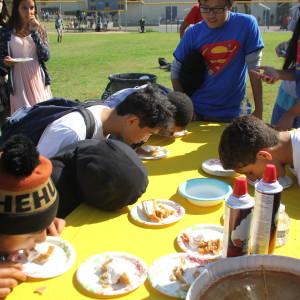 S-House students compete in a pie eating contest during the S-House annual Fall Festival.