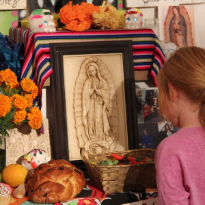 A young girl appreciates the art at Samo's Day of the Dead art show.