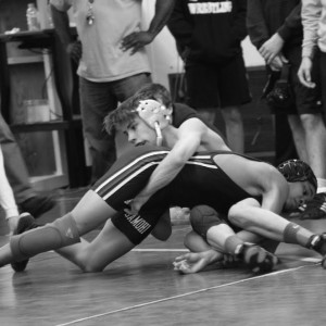 Nasir Grimson ('17) tries to fight his way out of the grasp of Redondo Union opponent.