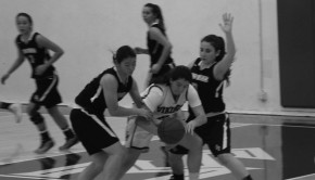 Erica Tejeda ('15) keeps the ball in possession against two Palos Verdes High School opponents on Feb. 8.