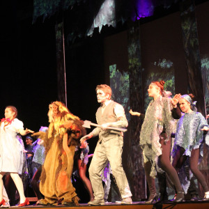 Hannah Hayes as the Scarecrow (left), Ciara Brewer as Dorothy (center left), Caroline Macou as the Cowardly Lion (center right) and Ronald Harris as the Tin Man (right) dance the Jitterbug in the Scary Forest.