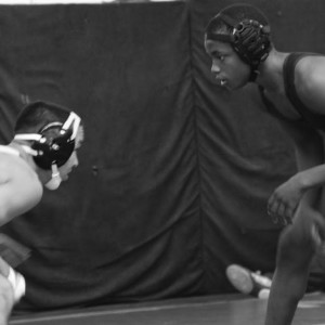 Haraldo Nesbeth ('16), right, sizes up his opponent during a wrestling match at Samo
